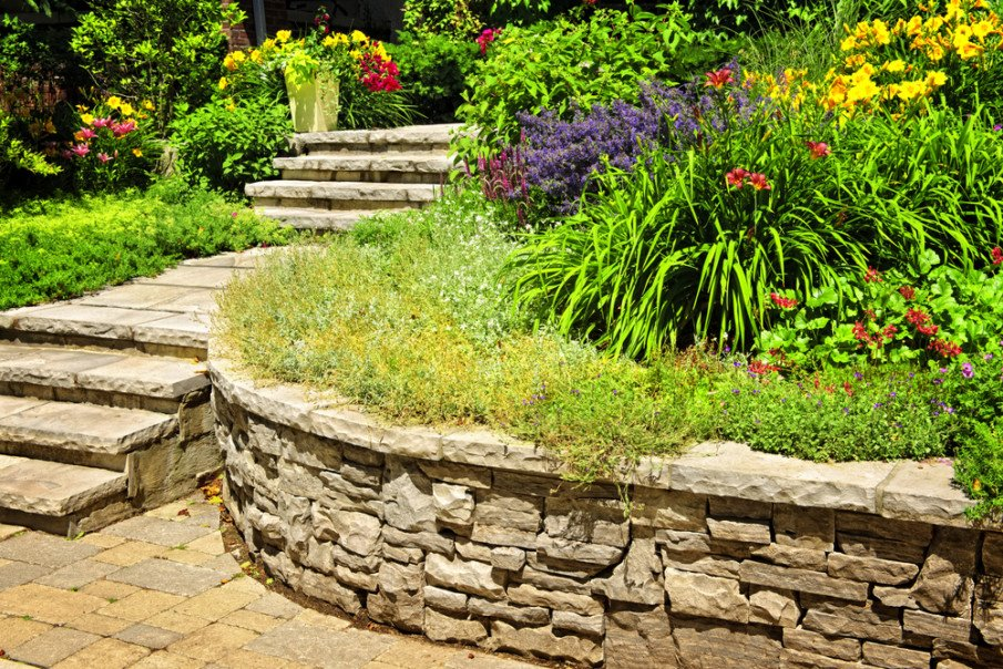 Curved natural stone wall with landscaping