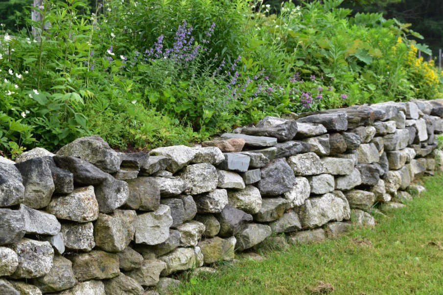Rustic retaining wall in landscaped garden