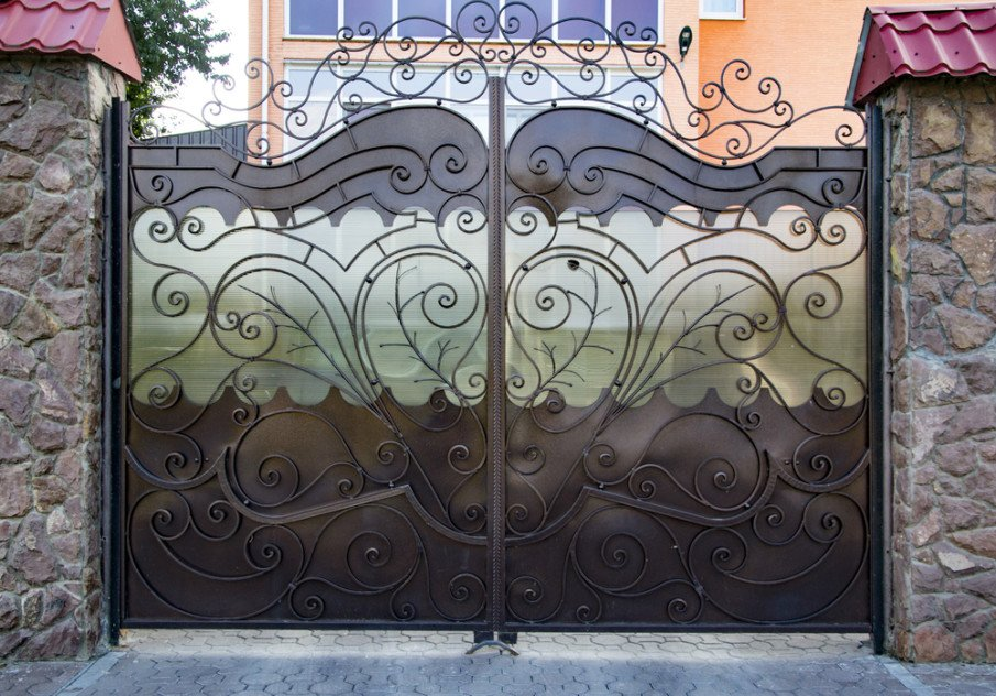 Ornamental wrought iron fence gate design with privacy screen