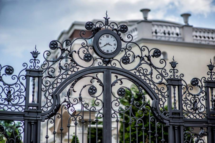 Ornamental gate design with a clock
