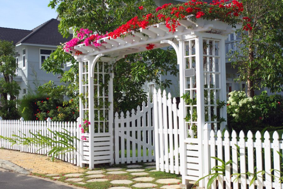 Amazing ideas of a pergola arbor over white gate covered with flowers