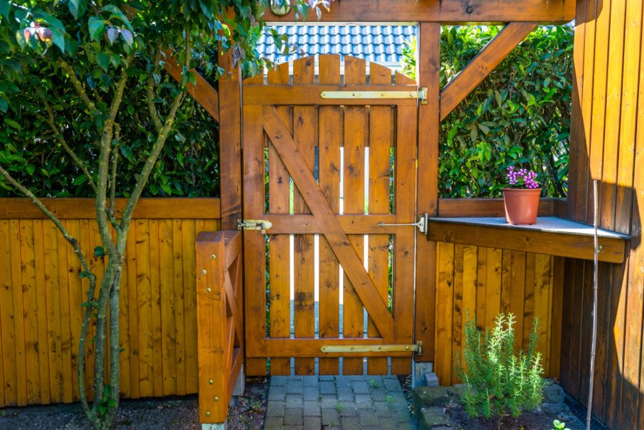 Creative entrance design with pergola roof and a flower pots shelf