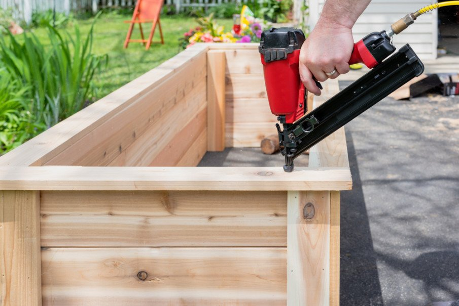 Building a DIY raised bed with a nail gun