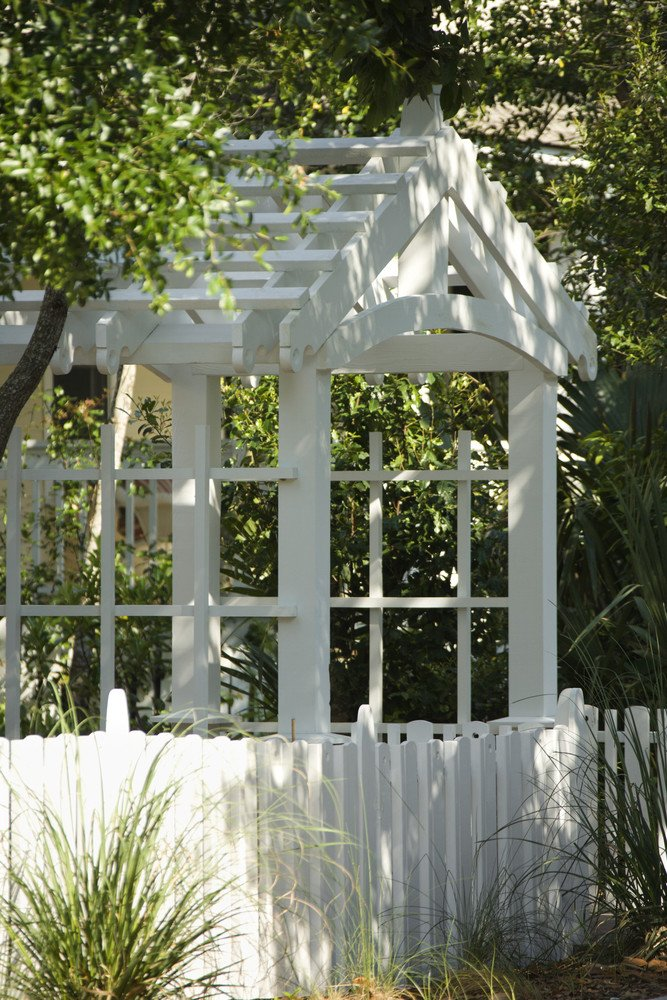Pergola roof arbor with gate and matching white fence