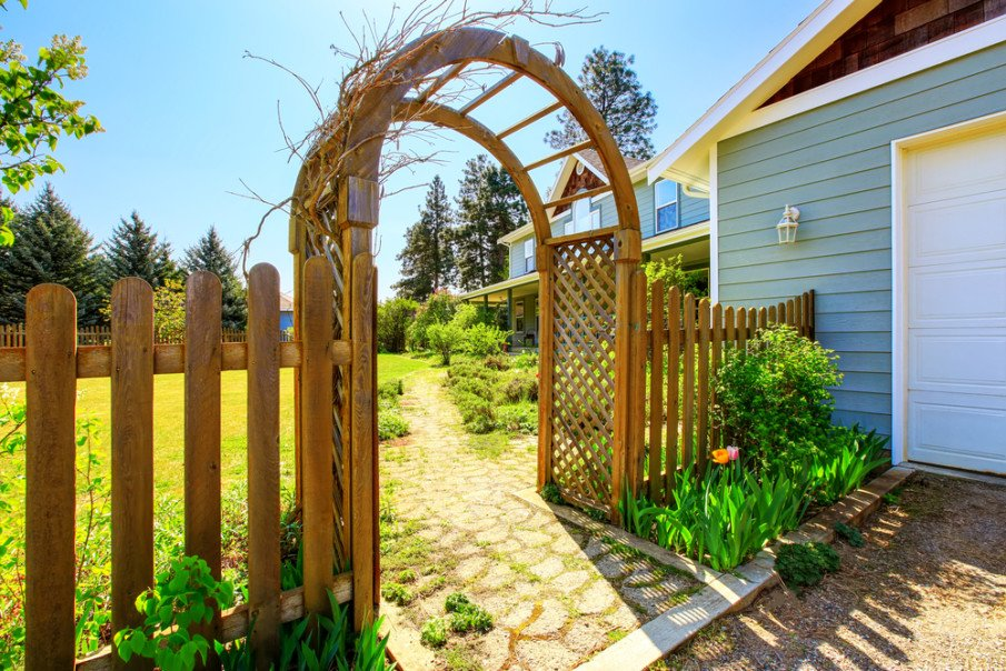 Wooden arbor with trellis and fence ideas