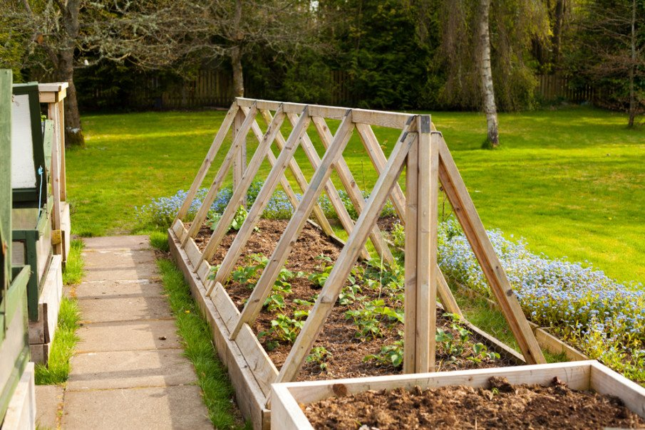 A permanent wood frame over a raised bed idea