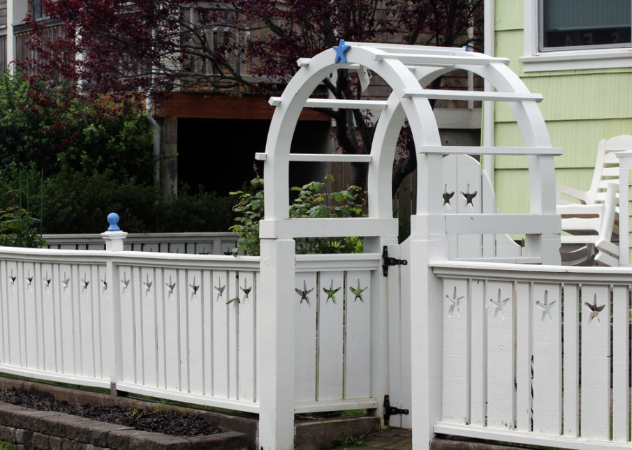 Arbor with gate and matching fence designs