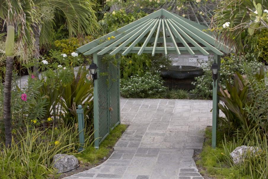 Pergola style wooden arbor with creative roof design